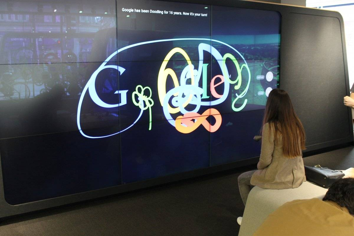 the-shop-also-has-lots-of-quirks-and-experimental-pieces-of-tech-for-curious-customers-to-play-with-this-is-the-doodle-wall-where-people-can-use-virtual-spray-paint-to-make-murals