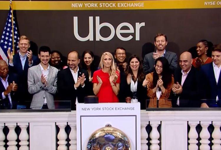 金发红裙的Austin Geidt为Uber敲响上市钟图:CBS