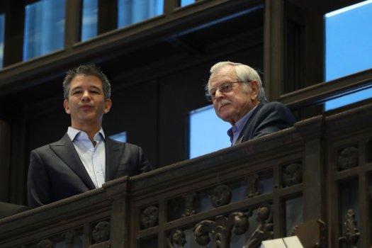 Kalanick和父亲在纽交所观看上市仪式图:Mercury news