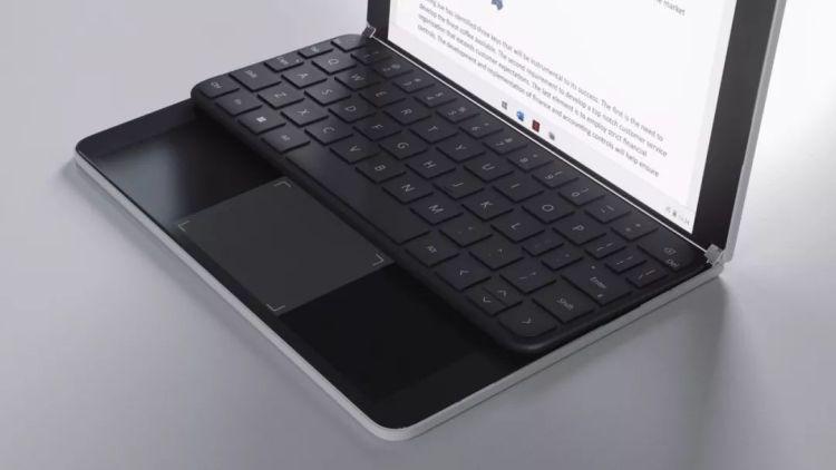 实体键盘靠上,多了一个触控板