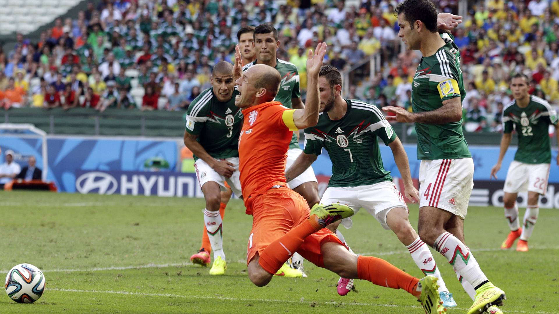 Netherlands' Arjen Robben, center, goes down to win a penalty during the World Cup round of 16 soccer match between the Netherlands and Mexico at the Arena Castelao in Fortaleza, Brazil, Sunday, June 29, 2014. Netherlands won the match 2-1. (AP Photo/Wong Maye-E)
